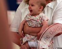 daisy baby smiling